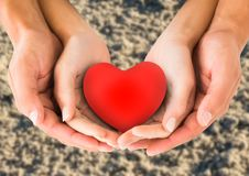 Couple holding heart shape in cupped hands Stock Photography