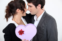 Couple holding heart-shaped box Royalty Free Stock Photography