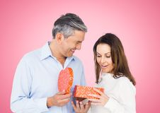 Couple holding heart shaped gift box Royalty Free Stock Photos