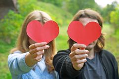 Couple holding hearts Stock Images