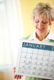 Couple: Holding a January Calendar Stock Photography