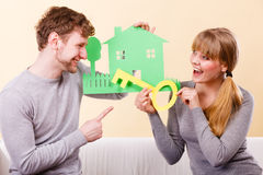 Couple holding key and house cutouts. Stock Photography