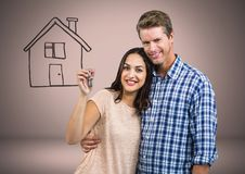 Couple Holding key with house drawing in front of vignette. Digital composite of Couple Holding key with house drawing in front of vignette Stock Photography