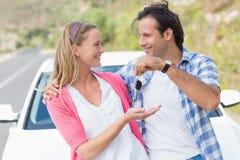 Couple holding key Royalty Free Stock Photo