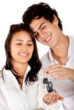Couple holding keys Royalty Free Stock Photos