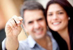 Couple holding keys Stock Image