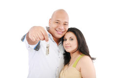 Couple holding keys. Young smiling couple holding keys of their new house Stock Photography