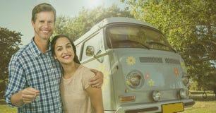 Couple Holding Keys with camper van in Summer. Digital composite of Couple Holding Keys with camper van in Summer Stock Photo