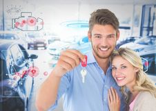 Couple Holding Keys with cars. Digital composite of Couple Holding Keys with cars Stock Images