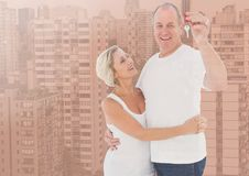 Couple Holding Keys with city. Digital composite of Couple Holding Keys with city Royalty Free Stock Photo