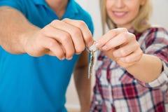 Couple holding keys Stock Image