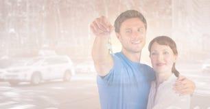 Couple Holding Keys. Digital composite of Couple Holding Keys Stock Images