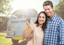 Couple holding keys in front of Camper van. Digital composite of Couple holding keys in front of Camper van Royalty Free Stock Photo