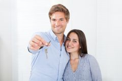Couple holding keys in new house Royalty Free Stock Photo