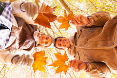 Couple holding leaves Royalty Free Stock Photos