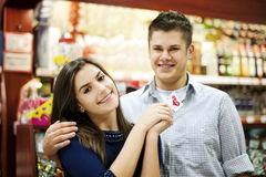 Couple holding lollipop in their hands. Supermarket: couple holding lollipop in their hands Stock Photos