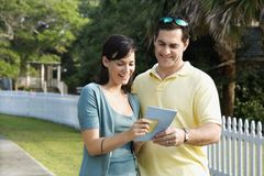 Couple holding a map Stock Image