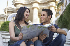 Couple Holding Map On Steps Royalty Free Stock Images