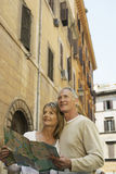Couple Holding Map On Street In Rome Royalty Free Stock Photo