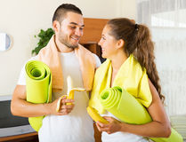 Couple holding mats and taking Royalty Free Stock Images