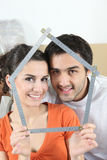 Couple holding measuring device Royalty Free Stock Photography
