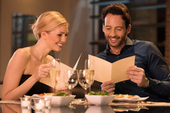 Couple holding menu cards Royalty Free Stock Image