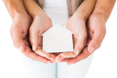 Couple holding miniature house in hands Royalty Free Stock Photos