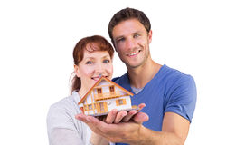 Couple holding a model house Stock Photos