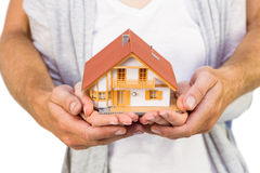 Couple holding a model house Stock Image