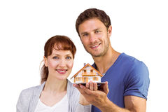 Couple holding a model house Royalty Free Stock Photo