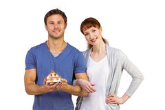 Couple holding a model house Royalty Free Stock Image
