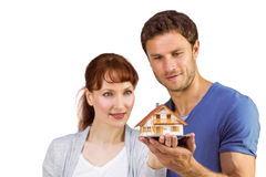 Couple holding a model house Royalty Free Stock Photography