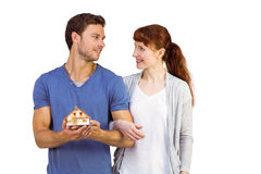 Couple holding a model house Royalty Free Stock Photos