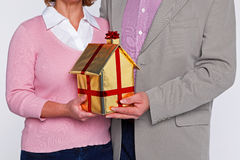 A couple holding a new home Royalty Free Stock Images
