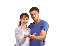 Couple holding out their hands Stock Images