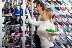 Couple holding pair of sport shoes royalty free stock photography