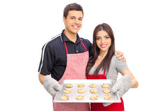 Couple holding a pan full of chocolate chip cookies Stock Image
