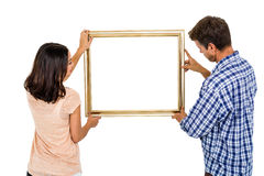Couple holding picture frame Royalty Free Stock Photos