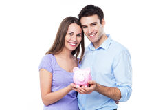 Couple holding piggy bank Royalty Free Stock Photos