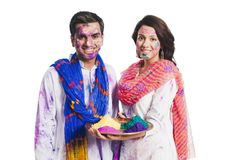 Couple holding plate of colors on Holi Royalty Free Stock Photography