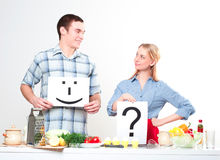 Couple holding a plate with signs Royalty Free Stock Photo