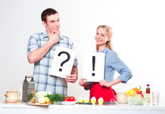 Couple holding a plate with signs Stock Photo