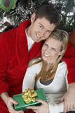 Couple Holding Present Embracing Royalty Free Stock Photography
