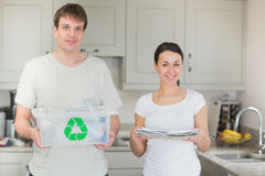 Couple holding recycling bin and newspapers Royalty Free Stock Photo