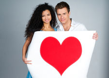 Couple holding a red heart Royalty Free Stock Photography