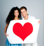 Couple holding a red heart Stock Photo