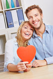 Couple holding red heart in living Royalty Free Stock Photography