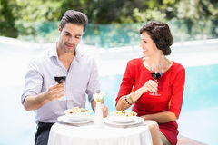Couple holding red wine glasses Stock Images