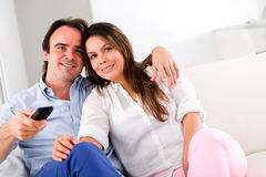 Couple holding a remote control Stock Images