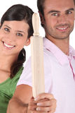 Couple holding rolling pin Royalty Free Stock Photography